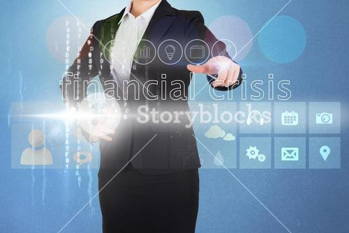 Businesswoman touching the words financial crisis on interface