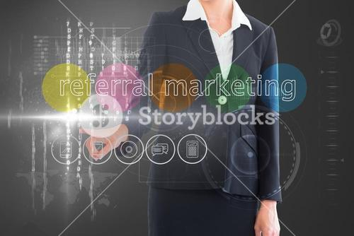Businesswoman touching the words referral marketing on interface
