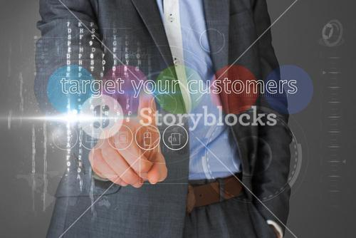 Businessman touching the words target your customers on interface