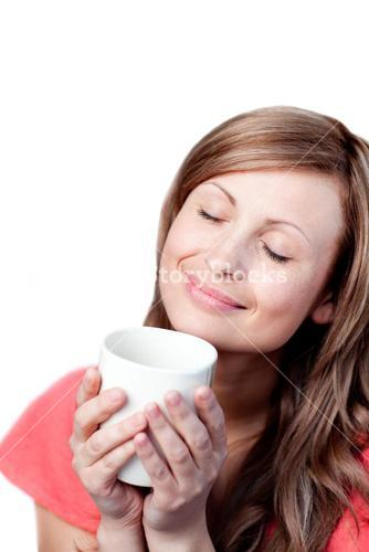 Radiant woman holding a cup of coffee