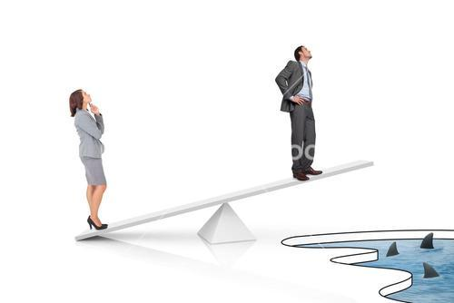 White scales measuring businessman and businesswoman