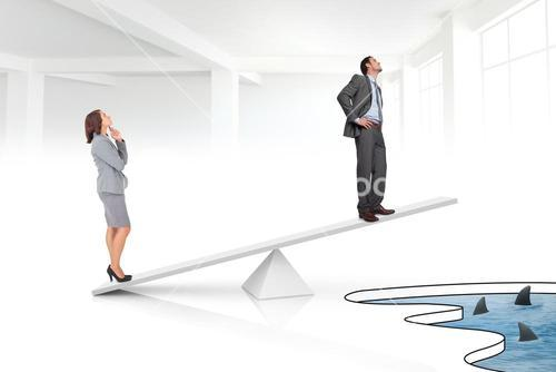 White scales weighing businessman and businesswoman