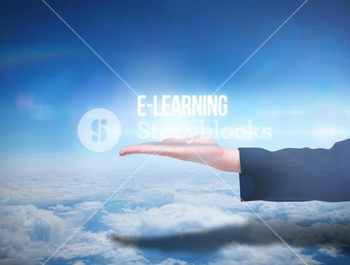 Businesswomans hand presenting the word e learning