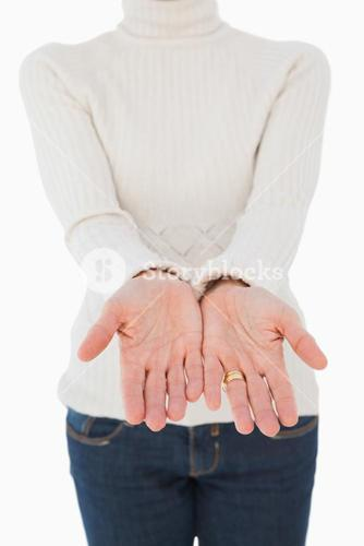 Woman standing with her hands out