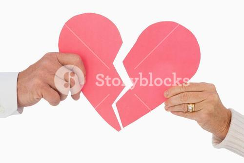 Couple holding a broken paper heart