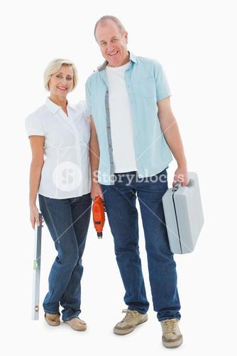 Happy older couple holding diy tools