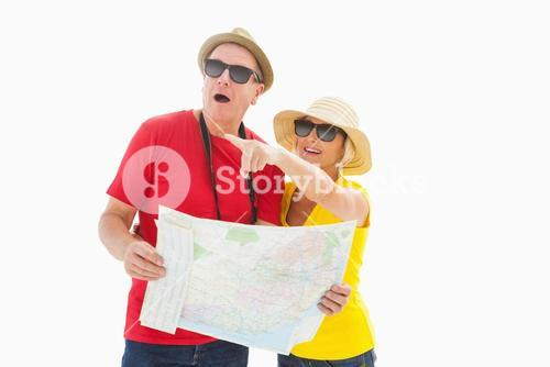 Happy tourist couple using map