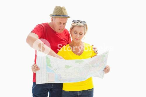 Lost tourist couple using map