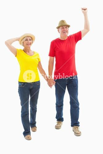 Mature couple walking and holding hands