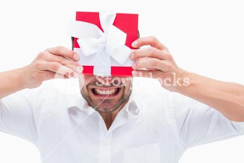 Stressed man holding a present
