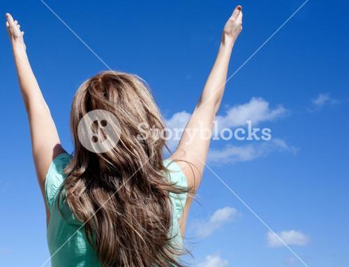 Woman punching the air outdoor