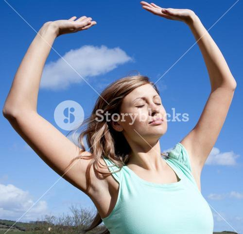 Successful woman punching the air outdoor