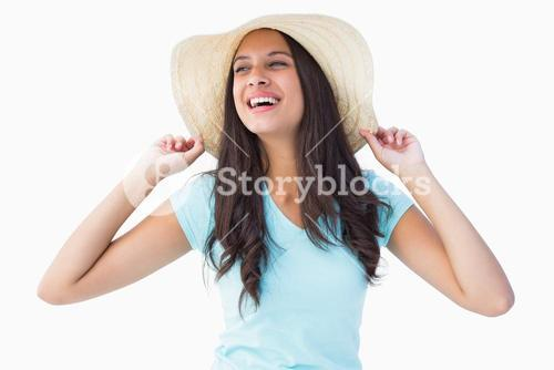 Happy young brunette wearing sunhat