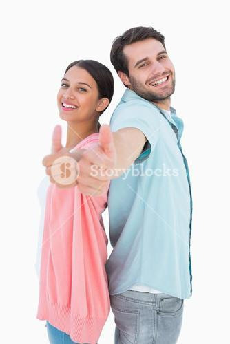 Happy couple showing thumbs up