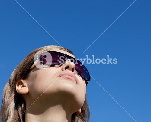 Delighted woman is wearing glasses outdoor