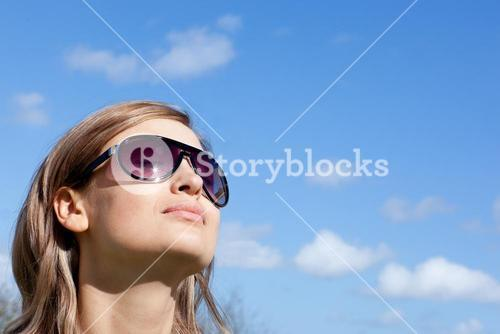 Radiant woman is wearing glasses outdoor