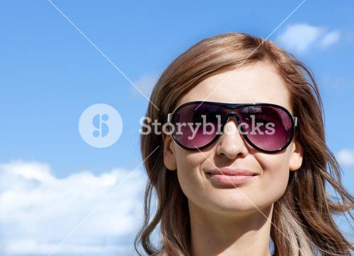 Woman is wearing glasses outdoor