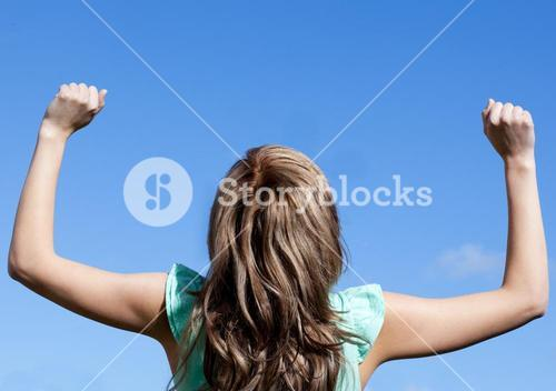 Attractive woman punching the air outdoor