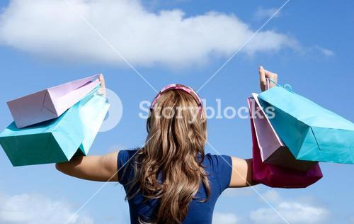 Happy woman holding shopping bags outdoor