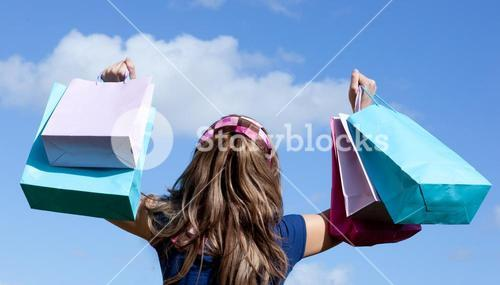 Cute woman holding shopping bags outdoor