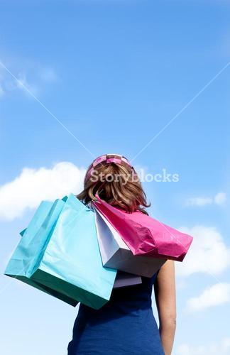 Smiling woman holding shopping bags outdoor