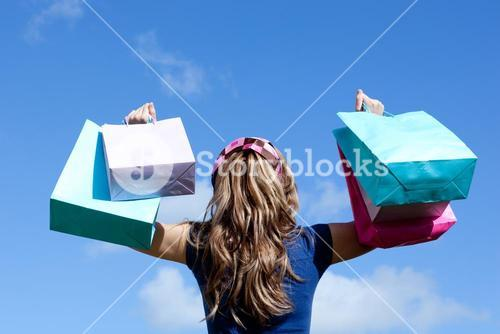 Young woman holding shopping bags outdoor