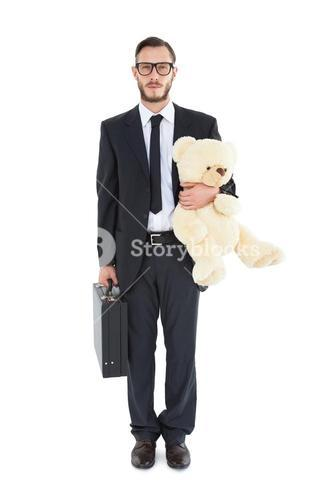 Geeky businessman holding briefcase and teddy