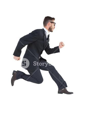 Geeky young businessman running mid air