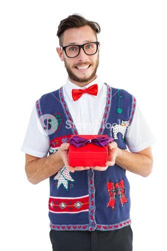 Geeky hipster offering christmas gift