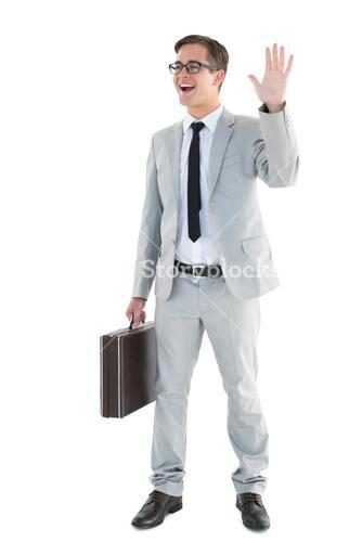 Handsome businessman waving and smiling