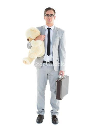 Handsome businessman holding briefcase and teddy