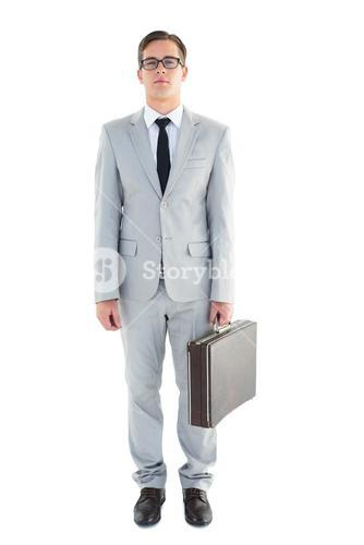 Geeky businessman holding his briefcase