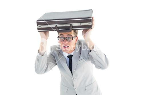 Geeky businessman holding his briefcase over head