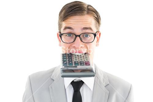 Geeky smiling businessman biting calculator