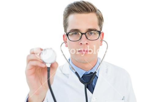 Handsome doctor listening with stethoscope
