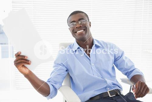 Happy businessman holding a page