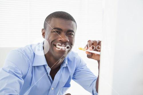 Happy businessman with electronic cigarette