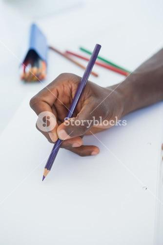 Man drawing with colour pencils