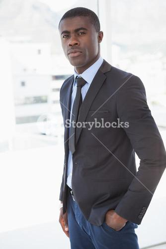 Handsome businessman frowning at camera
