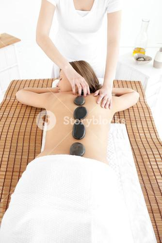 Delighted woman having a massage