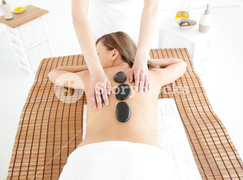 Attractive woman lying on a massage table