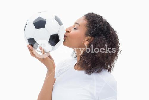 Pretty girl kissing her football