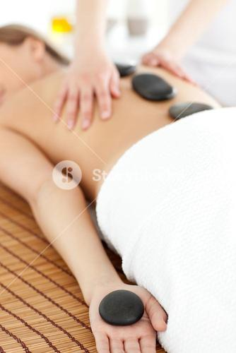 Close up of a bright woman relaxing on a massage table