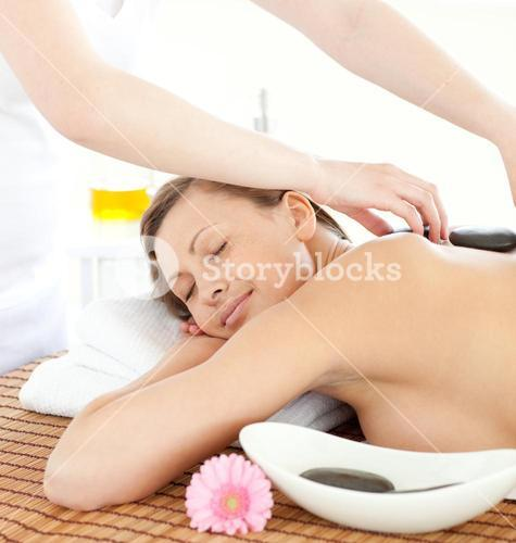 Portrait of a relaxed woman having a massage with stones