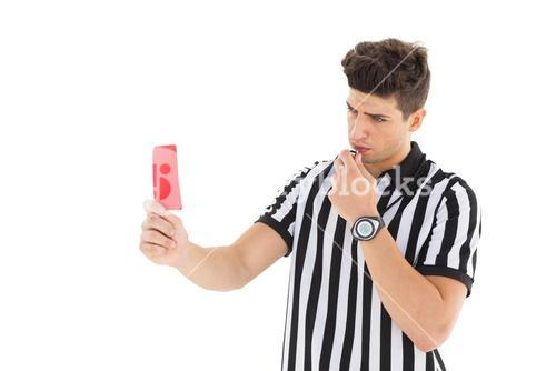 Stern referee showing red card