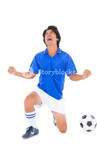 Football player in blue celebrating