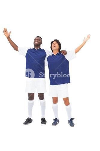 Football players in blue celebrating