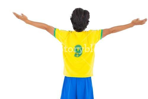 Football player in yellow celebrating a victory