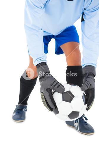 Goalkeeper picking up the ball