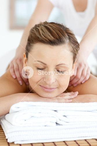 Radiant woman enjoying a back massage